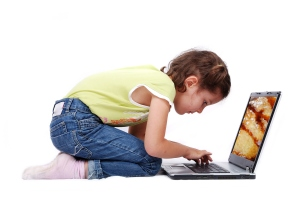 happy young girl with laptop computer isolated